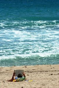 256px-Woman_reading_on_the_beach