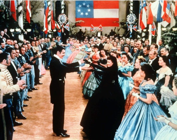 "**FILE** Rhett Butler and Scarlett O'Hara are seen dancing in this scene from the movie ""Gone With the Wind,"" in the late 1930s.  The American Civil War saga starring Clark Gable, center, and Vivien Leigh, in black dress,  is the most-watched movie in British history, according to the British Film Institute, Sunday Nov. 28, 2004.(AP Photo/New Line Cinema, File)"